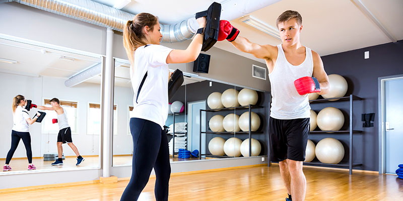 two-focused-people-training-boxing-at-the-fitness-PYK42YA